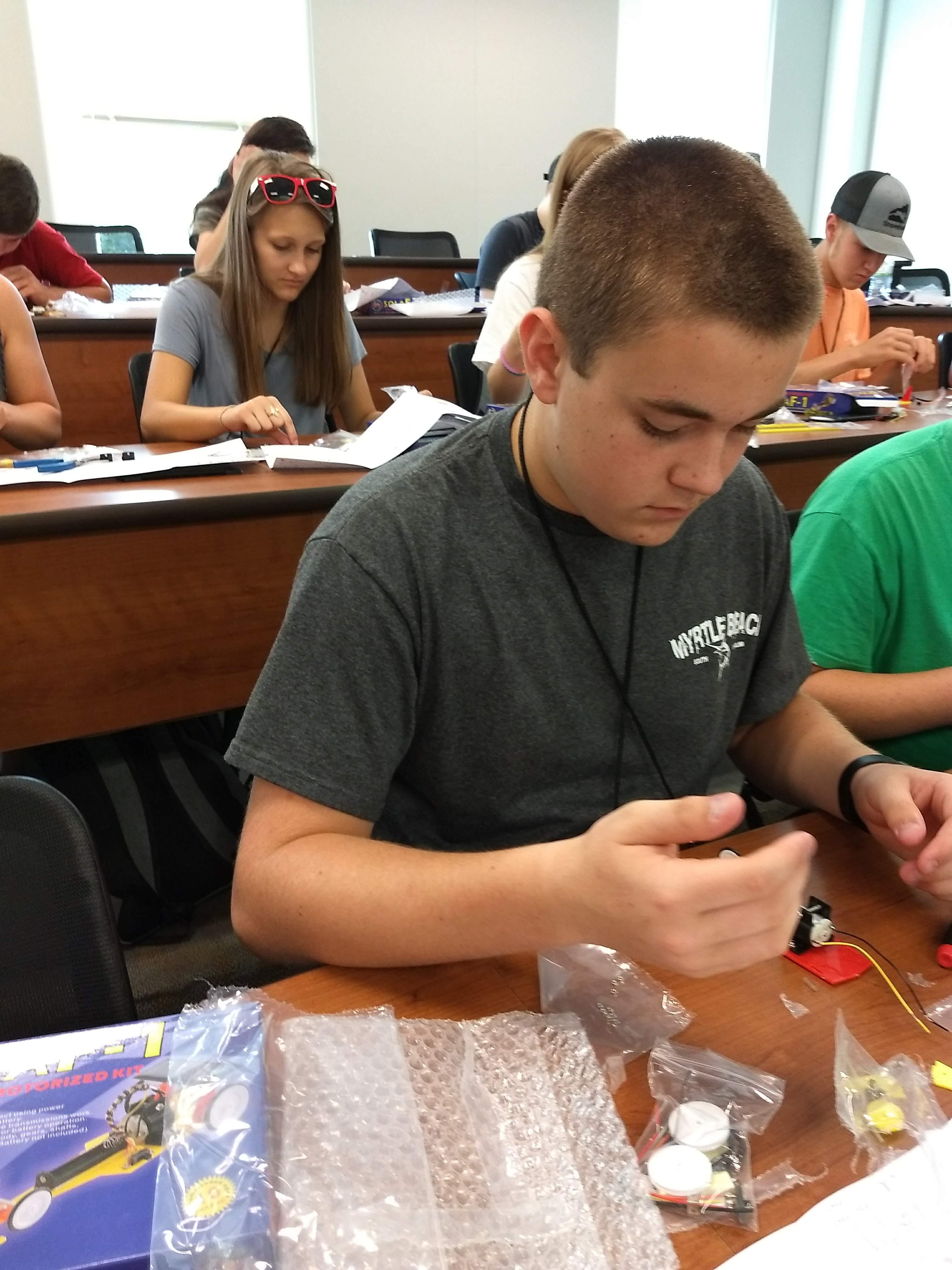 Isaac Brown working on his solar car during the renewable energy workshop