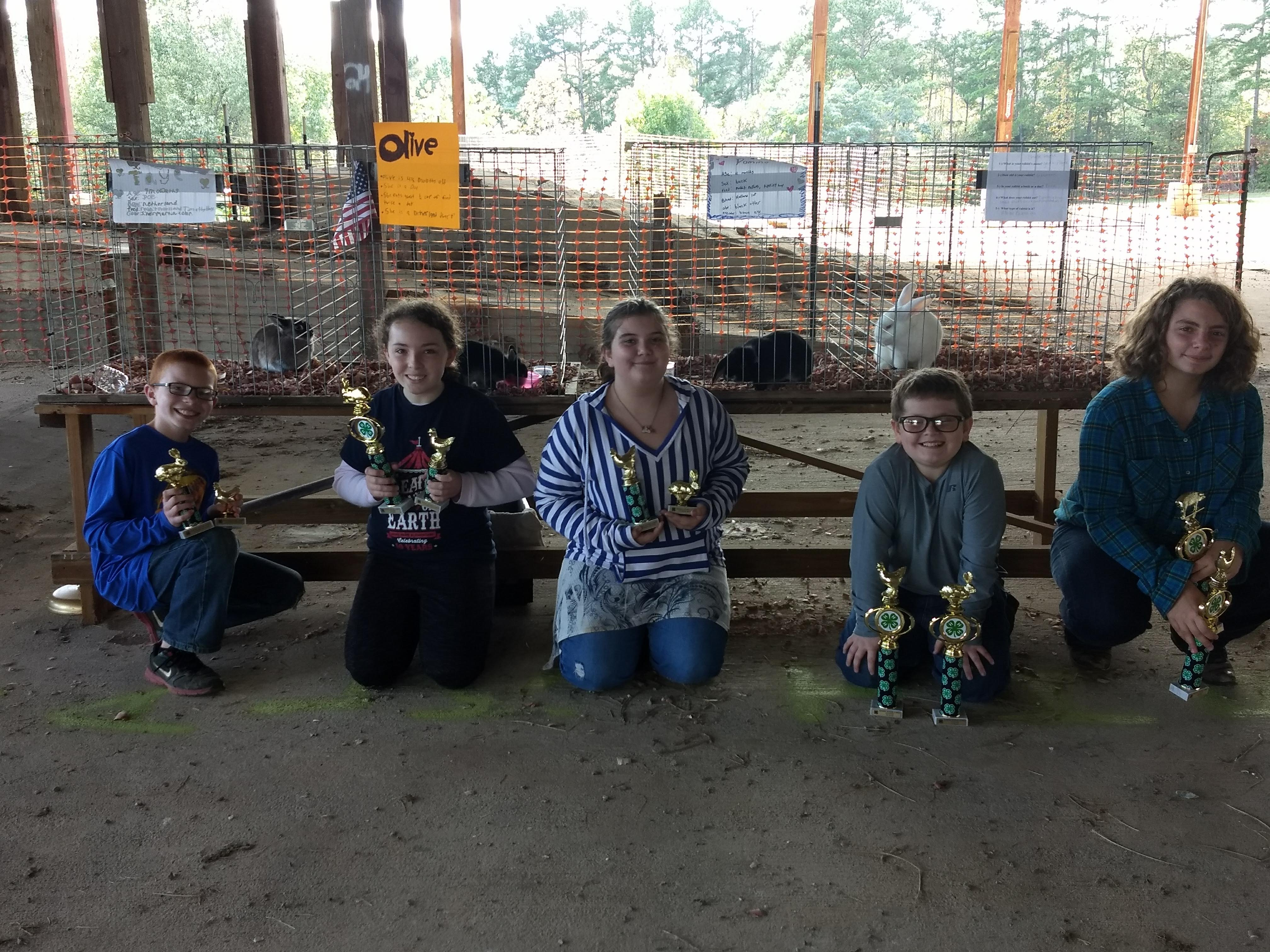 Image of kids with trophies