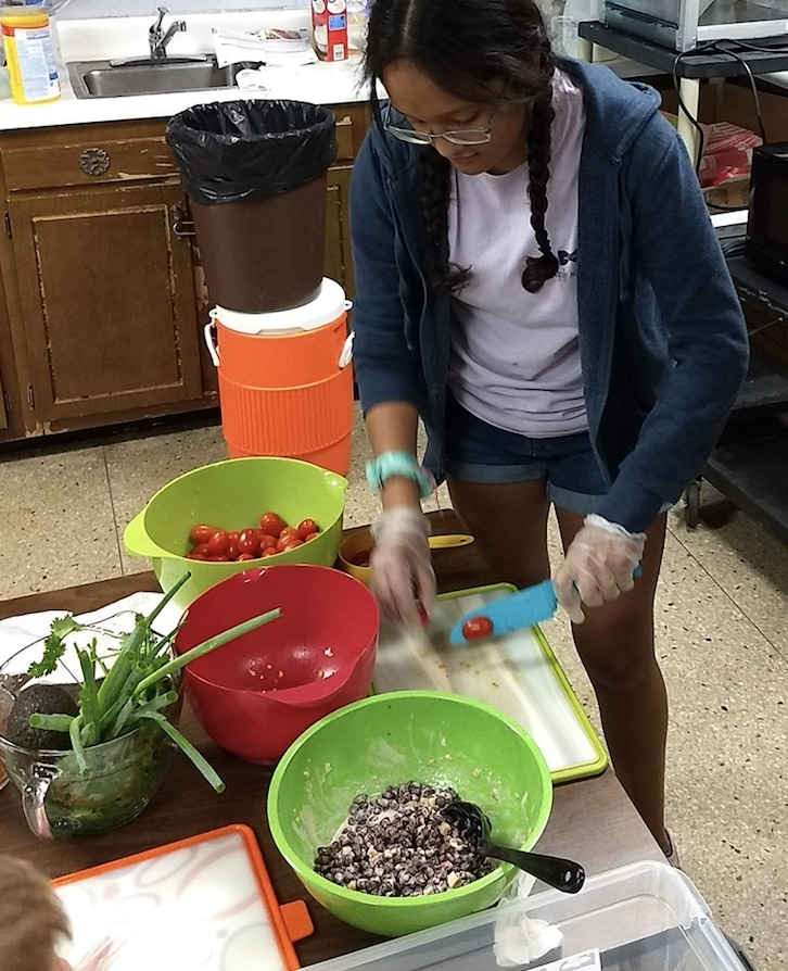 Image of child cutting vegetables