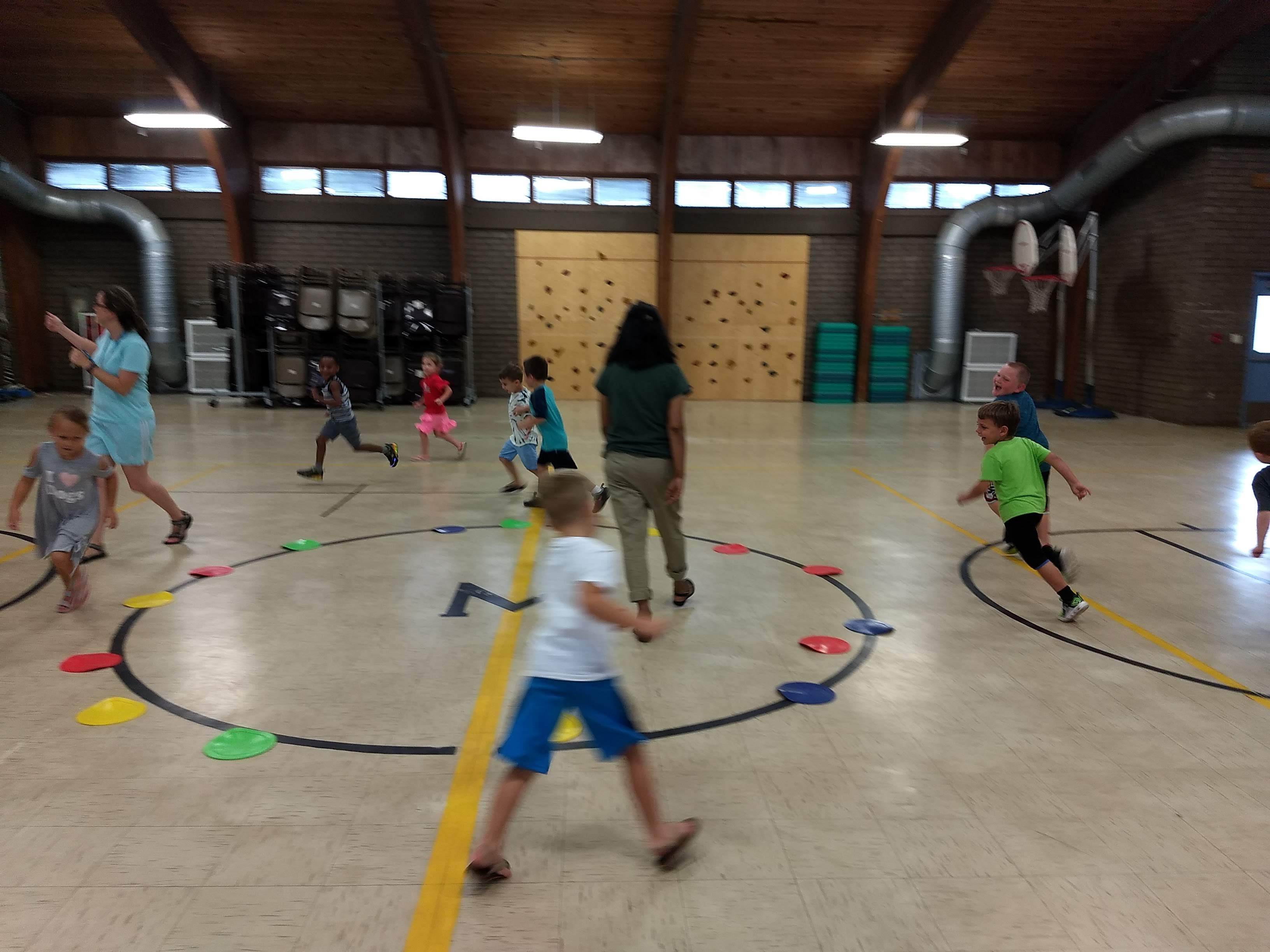 Image of kids playing in a gym