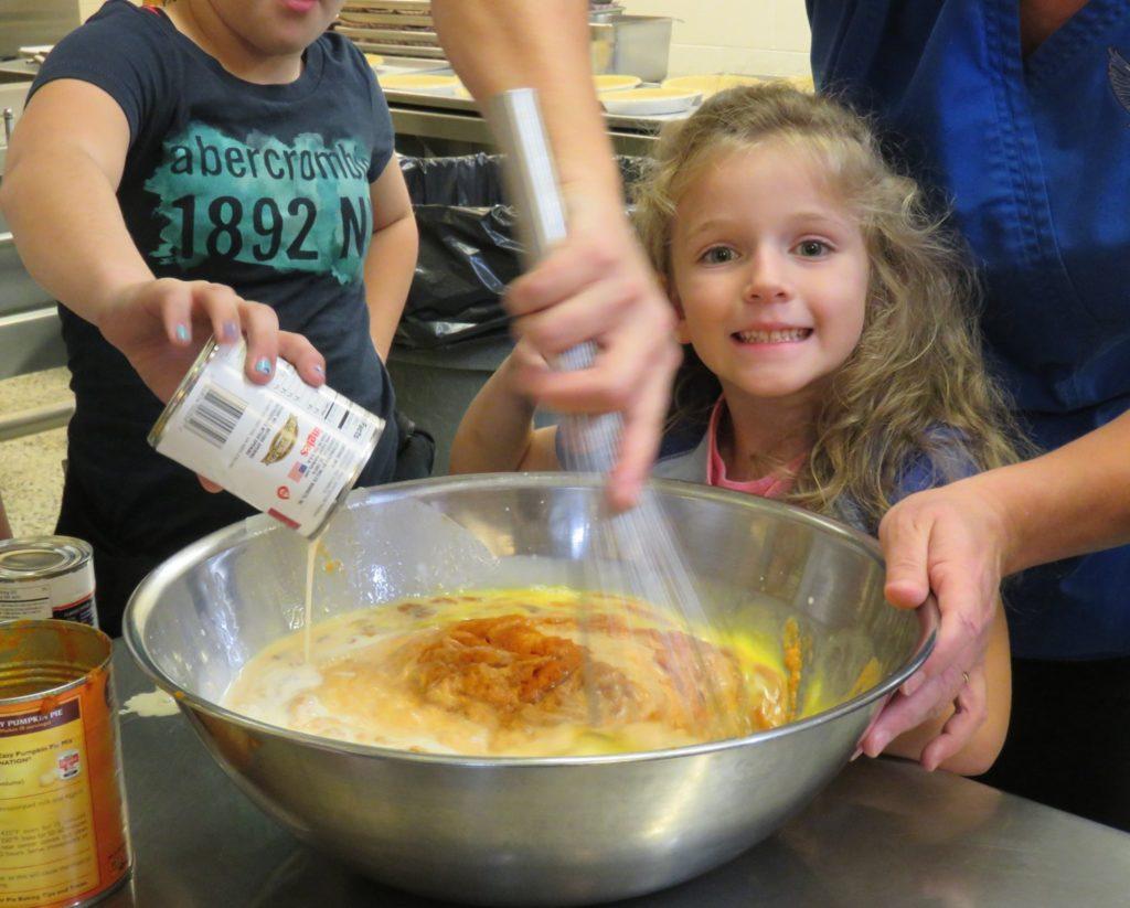 Image of girl stirring ingredients