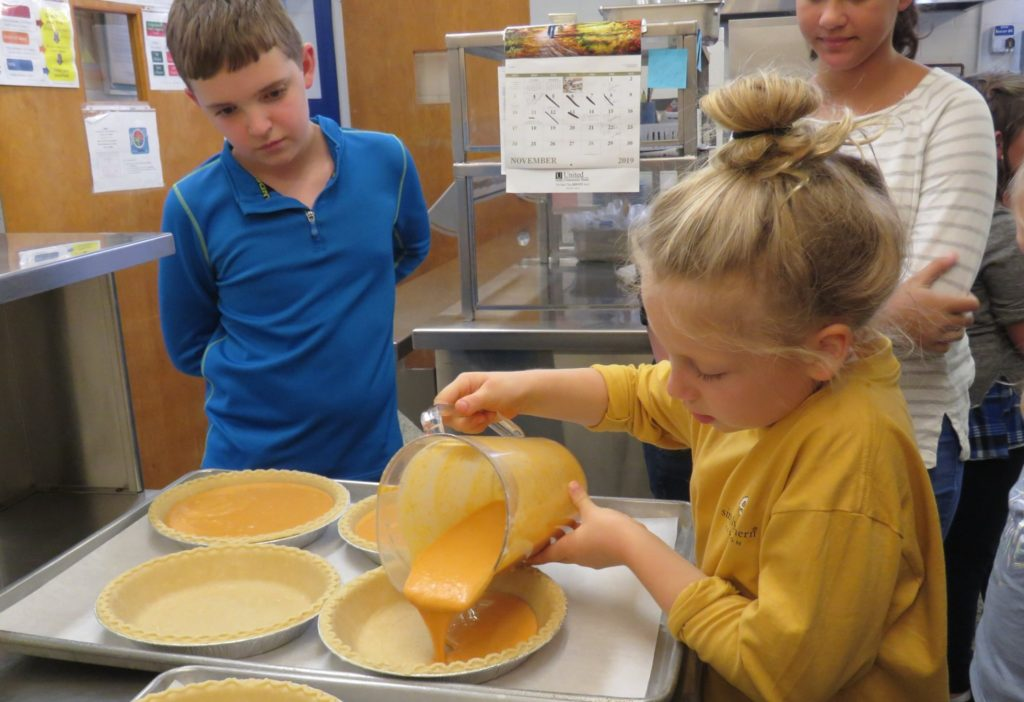 Image of girl pouring batter