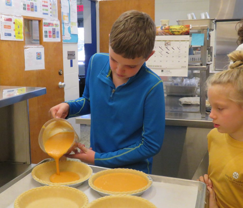 Image of boy pouring batter