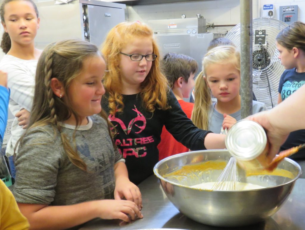 Image of kids making a pie
