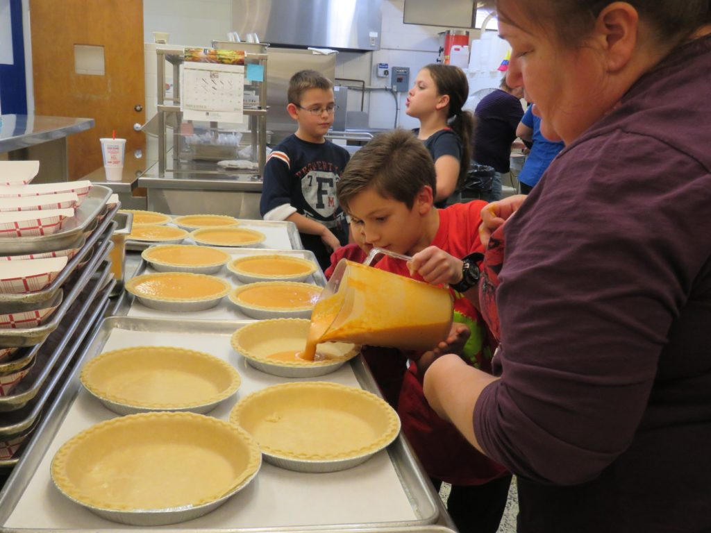 Image of boy making pie